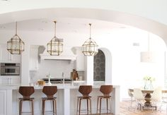 Before and After White Modern Kitchen - Owens and Davis The chandelier