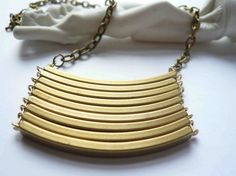 Brass necklace. via minusOne on Etsy.