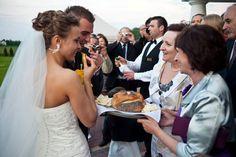 Traditional sharing of bread, salt, and vodka at a Polish wedding reception