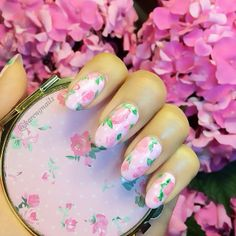 It doesn't get more girly than floral nails. #nailart #flowers #rosebuds #peonies #bloom #pink #prettypastels