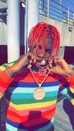 The bright front light on Lil Yachty helps to make the colors in his striped shirt more vibrant. It was smart of them to take a photo with such intense lighting because with all the the different color on him, he really stands out despite the entire picture being bright.