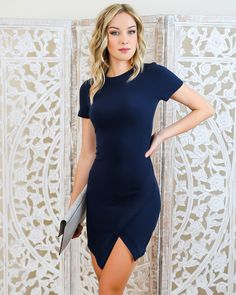 Loving our body con style Evan Dress. A fitted style with stretch and structure. Exposed back zipper and a chic asymmetrical hem. A show stopping dress that transitions beautifully from work to weekend. Paired with our Kimber Clutch and Fringe Forever Heels.