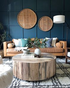 Living rooms you'll want to copy immediately love the deep blue color of this wall. Paired with a brown couch. 's beautiful! Blue and white rug help Brown Couch Living Room, Boho Living Room, Dark Grey Walls Living Room, Blue And Brown Living Room, Living Room Paint, West Elm, Blue And White Rug, Living Room Inspiration, Feng Shui