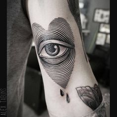 Heart eye tattoo on the left bicep.
