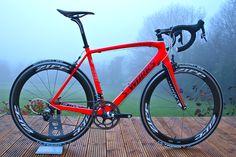 2011 Specialized S Works Custom. Neon Red S works bicycle with SL3Tarmac, Zipp 404 wheel set, FSA CSI stem & FSA K Force handlebars. http://www.ciclisport.com/?page_id=24