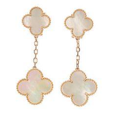 VAN CLEEF & ARPELS - a pair of mother-of-pearl 'Alhambra' ear pendants.