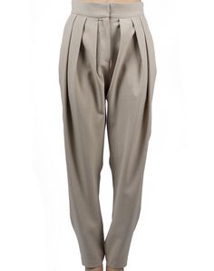 Draped Trousers - Sand $109.00  Draped pants in sand, with high waist and long shot. Made from 100% polyester.