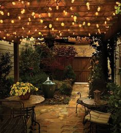 Topology-Athina-Bluff-Outdoor-Lighting-Ideas - an outdoor room created with a pergola and lighting