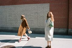 Datura Blog - East Village GirlsDatura Blog - East Village Girls  Andrea wearing our Rust Kimono Coat and Dress and Zaga wearing our Ivory Tusk Escape Coat and dress. Picture by Ana Kras