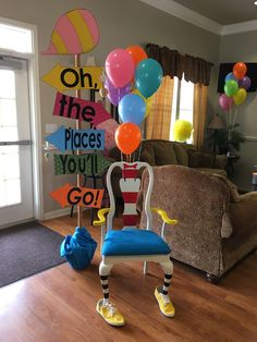 """Graduation party with """"oh the places you'll go"""" theme. This is the chair for the guest of honor."""