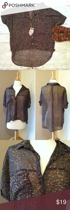 """Lush sheer animal print hi/low button down Sheer olive material with cheetah prit. Button down. One bust pocket. Hi/low hem. Cuffed sleeves. In excellent condition. Super cute with cutoffs and a bandeau under for breezy cool style. 0r with a cami and a pencil skirt for aclassy yet trendy vibe. 100% polyester. 22.5""""L in front, 29""""L in back. Size Medium. Urban Outfitters Tops"""
