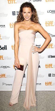 All the Looks from the Toronto Film Festival | KATE BECKINSALE | Kate's movie The Face of an Angel may be a dark one, but for the premiere she picks something not-so-dark: a pale-pink Azzaro Couture jumpsuit with a floor-grazing sash hanging from the waist.