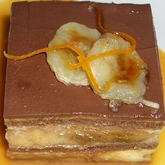 An easy no bake banana chocolate recipe that the kids will keep asking for.. Banana Cream Pie Chocolate Squares Recipe from Grandmothers Kitchen.