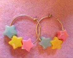 Put some star pony beads on hoops. GENIUS.