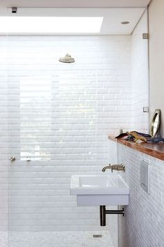 Like the big shower, Really love the wall hung sink with wall faucet and ledge.  Definitely something we could do.