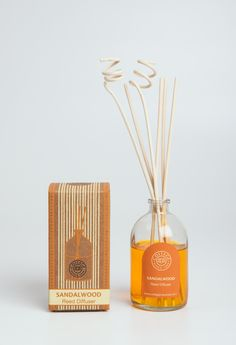 Ethnic and earthy packaging design for the sandalwood reed diffuser box and bottle label. This is one from the range of reed diffusers by Cottage Industries, Pondicherry.