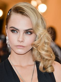 For a white tie wedding, consider tight curls like model Cara Delevingne.