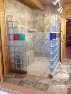 a glass block shower in a log home combining rustic and contemporary styles