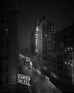 cica 1950. Night signs of the Gunter Hotel and the Majestic Theatre line E. Houston Street.