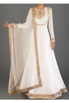 White and Gold Embroidered Dhupioni Silk Anarkali is on dhupioni silk fabric and features a santoon inner and bottom alongside a net dupatta. Embroidery work is completed with zari and stone work embellishments. Pakistani Dress Design, Pakistani Outfits, Indian Outfits, Farasha Abaya, Mode Bollywood, Designer Anarkali Dresses, Indian Gowns Dresses, Dress Indian Style, Indian Designer Outfits