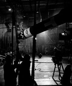 """On the set of """"Doctor Strangelove"""" (1964). Slim Pickins who played the role of Major T. J. """"King"""" Kong is about to ride """"the bomb"""" in one of the best known scenes of the film. Peter Sellers played three roles in the film and was due to play the role of Major Kong but received an ankle injury in filming so Slim got the role."""