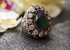 A personal favorite from my Etsy shop https://www.etsy.com/listing/493675164/emerald-diamond-ring-silver-broonze-ring