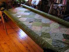 DIY quilting frame sort of like 2 saw horses for adjustable quilting depending on size of quilt.