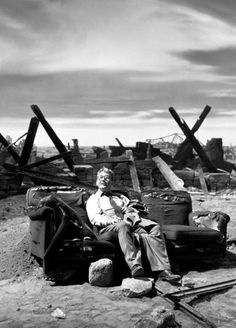 """Burgess Meredith on the post-nuclear set of """"Time Enough to Last"""" (1959)  """"The best laid plans of mice and men and Henry Bemis, the small man in the glasses who wanted nothing but time. Henry Bemis, now just a part of a smashed landscape, just a piece of the rubble, just a fragment of what man has deeded to himself. Mr. Henry Bemis, in the Twilight Zone.""""  -Rod Serling, """"Time Enough at Last"""", The Twilight Zone"""