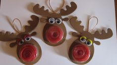 Getting Christmas happy! Made these today using Stampin Up sweet treat cups and wound some strawberry shoelaces into them for Rudolph's bright red nose :)  Something different to the usual chocolate tree decorations I think!