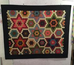 Stars in my Garden by Yellow Creek Designs.  1065  hexagons.  Quilted using silk thread and bamboo batting.