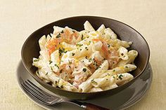 This luxuriously creamy, cheesy shrimp and pasta dish is brightened with a squirt of lemon and its zest. (Bonus: It's ready in 20 minutes, start to finish!)