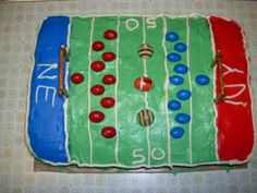 Superbowl Cake I like to make each year. I don't ever make cakes, but I think this is cute and easy!  Mix box of spice cake mix with 1 can pumkin pie filling, 3 lg eggs, 1/2 cup beer.  Bake at 350 for 30-35 minutes,  Decorate with butter cream icing, food coloring, peanut M's, Hershey hugs and foil covered chocolate football.  Goal posts made of pretzels glued together with icing.