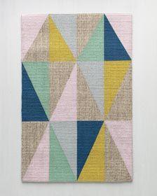 Use Martha Stewart Crafts Vintage Decor Matte Chalk Acrylic Paint and stencil tape to create a fun geometric rug.