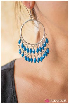 A silver hoop is adorned with strands of blue beads in a Bohemian-inspired fashion. Sold as one pair of earrings.