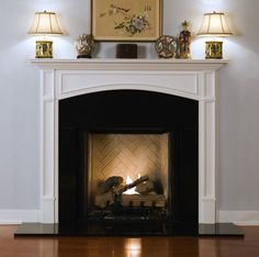 The framed legs and decorative molding makes this an exquisite fireplace mantel.