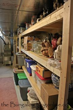 DIY sturdy shelves for basement organization. My garage has these same built in shelves on both sides. I seriously considered ripping them out when we bought and renovated it. Kinda glad I didn't now! Garage Storage Shelves, Basement Storage, Stair Storage, Storage Room, Storage Ideas, Diy Shelving, Diy Storage, Storage Solutions, Cool Diy Projects