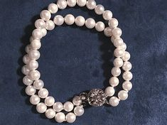 Newbridge Vintage Grace Kelly 2 Strand Pearl Bracelet Part of the Newbridge Princess Grace Collection. 2 Strand bracelet made with 6mm natural sea shell pearls coated with Mother of Pearl and fastened with a crystal stone clasp. Measures approx 20cm in length. Strand Bracelet, Pearl Bracelet, Pearl Necklace, Irish Jewelry, Vintage Pearls, Claddagh, Grace Kelly, Stones And Crystals, Bracelet Making