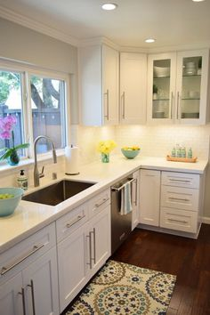 New Kitchen Reveal: A white kitchen is the perfect backdrop for colorful accessories, dishes and accents. All available at HomeGoods. Sponsored Pin.