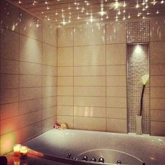 Starry bathroom. Simple cheap solution -  cover fluorescent lighting with panels that have holes poked into them.