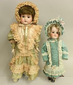 "22"" 370 AM-7-DEP SHOULDER HEAD AND 17 1/2"" MADE IN GERMANY 390 A.2 1/2.M. Both dolls have brown sleep eyes, open mouths, original mohair wigs. They are dressed in reproduction period clothing with matching bonnets. 22"" Doll - brown braided wig. Leather gusseted body with bisque lower arms. No shoes. Condition: mold imperfection on right ear. Cheek and nose rubs. 17 1/2"" Doll - tosca wig (thin on top). Papier mache ball jointed body. Antique underwear. Condition: large chip on rim edge. ..."