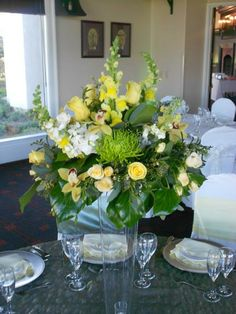 Tall Cylinder Centerpiece - green mums, orchids,roses and stock