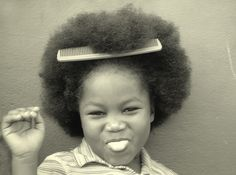 6 year old orphan named Marlene at New Vision Children's Home in Christiana, Jamaica proudly displays her big hair.
