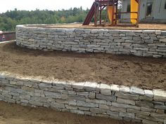 Natural stone retaining walls during construction by Bahler Brothers
