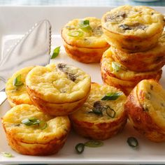 Cheesy Egg Puffs Recipe -My father loves to entertain, and these buttery egg delights are one of his favorite items to serve at brunch. The leftovers are perfect to reheat in the microwave on busy mornings, so Dad always stashes a few aside for me to take home once the party is over. —Amy Soto, Winfield, Kansas