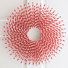Paper Straw Wreath. Do different colors for different holidays. AC Moore straws. *Use red and blue straws and gold stars for July!