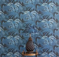 House of Hackney Palmeral wallpaper in Midnight & Azure is an Art Deco inspired patio print featuring an explosion of palm leaves reminiscent of 1930s Palm Springs. The print pays homage to Loddiges, one of the worlds largest palm houses based in Hackney during the Georgian period, once a Mecca for tropical plants, it was the original inspiration for many of the species at Kew Gardens today. Bring the outdoors into your home with this fresh foliage print.