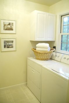 white-laundry-room-design-with-small-space-solutions  I like the idea of the cabinet on the side.