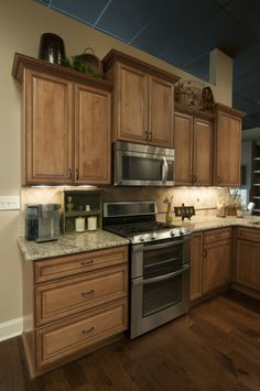 Bon Medium Wood Cabinets, Light Granite, Stainless Steel Appliances, Above  Cabinet Decor, Home