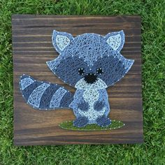 Adorable little Raccoon on a grass patch The example shown is on a 12x12 board Stain options are shown in the last picture, just be sure to include the color or stain you would like in the note to seller. We use high quality pine wood for all of our boards, and due to the beautiful grains in the wood the stains may appear slightly different in person. Sawtooth hangers will be included for easy hanging! If youre interested in different sizing, color options or have any custom ideas- feel free…