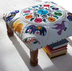 Colorful embroidered fabric on a stool